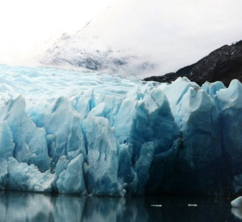 Science article about Climate change & sea level rise - confused how melting ice can cause water levels to rise?